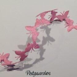 Lyserøde sommerfugle i bånd