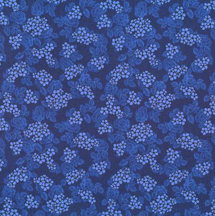Blå patchworkstof med blomster