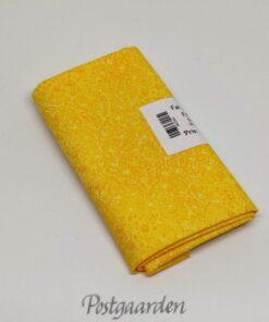 FQ7264 - Gul meleret patchworkstof med gule blomster